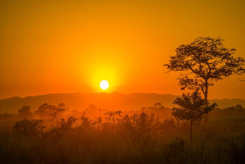 The Sun Setting Beneath The Mountain Range Kaziranga National Park, Assam, North-Eastern India