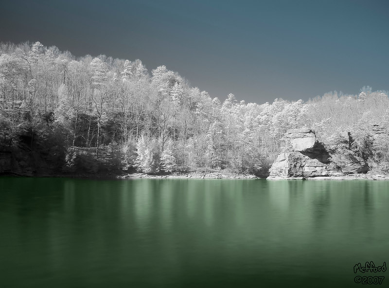 <p>16 February 2007.  IR shot of Laurel Lake.  <p/> <p>Photoshop (in layers):  Gradient (blue sky), Solid Color (Green Lake), Channel Mixer (desaturate), Curves, Lighten reflections in lake, unsharp mask.  <p/>