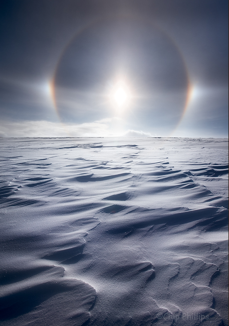 """""""The Opening of Heavens Gate""""  A Parhelic Circle, and Parhelia (the two patches on the sides of the circle),  seen over a snowy field near Grand Tetons National Park.   A rare phenomena where Ice crystals in the air reflect light, creating a giant circular rainbow."""