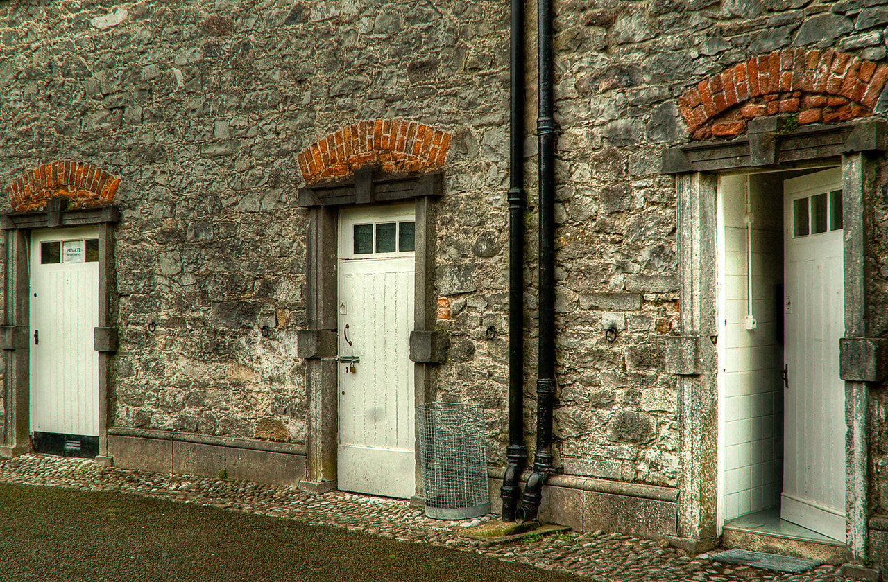 Enter Thru Here  The carriage house at Kilkenny Castle housed many of the retainers of the Earl and the Butler family.  Kilkenny, Ireland