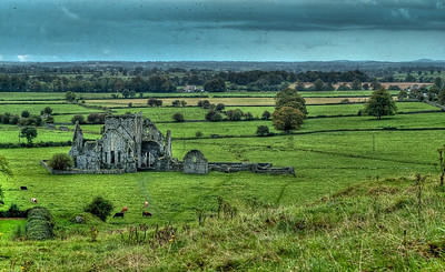 Ruins of Hoare   On a typical blustery Irish day, the ruins of Hoare Abbey, a Cistercian monastery near the Rock of Cashel, gaze over the quiet meadow.  The Butler family gained possession of the property in 1540  Tipperary, Ireland