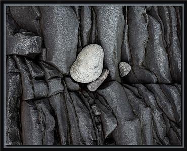 White stone on black lava
