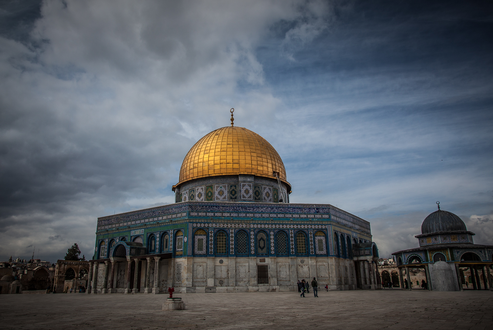 Dome of the Rock - The octagonal shire was built in the 7th century. Extensive decoration from a variety of periods, including mosaics, painted wood, marble, multi-colored tiles, carpets, and carved stone, covers most of the exterior and interior of the building.
