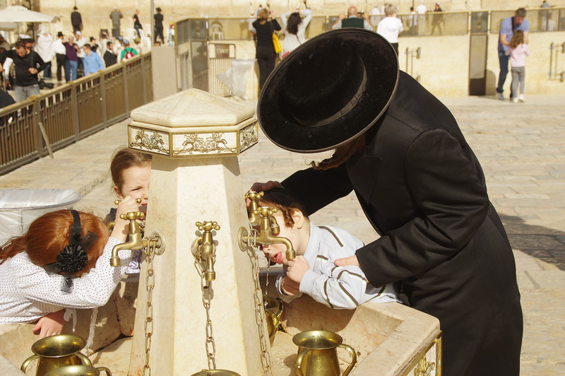 Drinking the holy water at the Western Wall