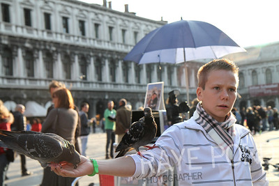 Random boy in San Marco Square feeding pigeons.