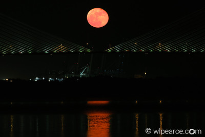 Full moon rising over the Dames Point Bridge, from Mill Cove.