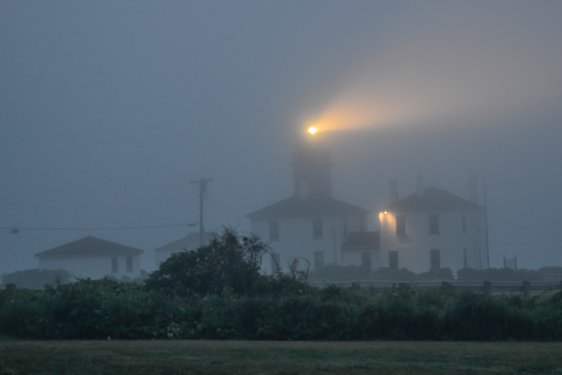 Beavertail Light in evening fog, Jamestown, Rhode Island.