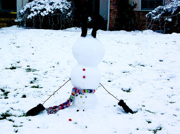 An upside-down snowman built by siblings Jena, Collin and Jill Hecht stands. The family got the idea from the bulletin board website Pinterest.