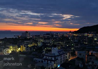 Sunrise over the city of Ito, on the eastern coast of Shizuoka Prefecture's Izu Peninsula, Japan.