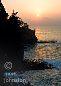 Sunrise on the eastern coast of rugged Izu Peninsula, Shizuoka Prefecture, Japan.