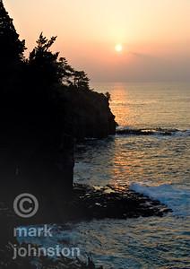 Sunrise on the eastern coast of rugged Izu Peninsula, Shizuoka Prefecture, Japan.