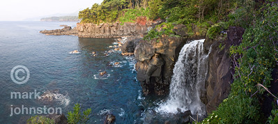 A waterfall pours mountain water into the ocean on the Eastern coast of Japan's Izu Penninsula.