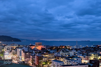 A cloudy evening settles over the city of Ito, on the eastern coast of Shizuoka Prefecture's Izu Peninsula, Japan.