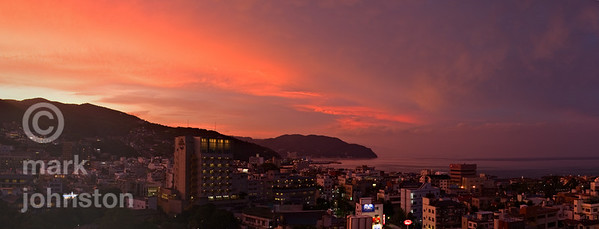 Flaming sunset over the city of Ito, on Shizuoka Prefecture's Izu Penninsula, Japan.
