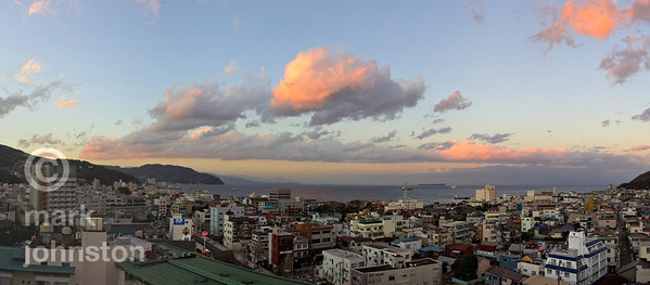 Sunset over the city of Ito, on the eastern coast of Shizuoka Prefecture's Izu Peninsula, Japan.