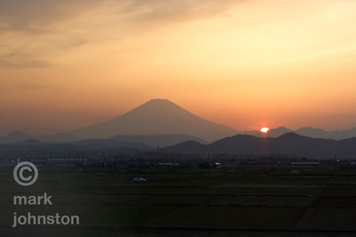 Sunset along the flank of Mt. Fuji, seen from the Shinkansen [bullet train] somewhere in Kanazawa Prefecture.