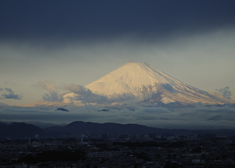 Mt. Fuji in the early morning light. A thick blue cloud over Fujisawa created the effect. Image shot as is.