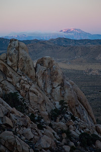 Good Morning, From Ryan Mountain to Mt. San Jacinto!  Last weekend I made an overnight trip to Joshua Tree.  It was a spur of the moment thing.  I decided to wake up before sunrise and attempt to get to the top of Ryan Mountain at the break of dawn.  I ended up half way up the mountain before the sun started hitting the tallest mountain in the area.  The sight was absolutely breathtaking.    The snow capped mountain in the distance is Mt. San Jacinto, which rises to 10,831 feet.  Mount Ryan is 5,457 feet at its' summit.  I will never, ever, climb with all my camera gear again!  This was the lesson I learned the hard way..  I should have just taken my 24-105L.    The climb was painful as I was moving quickly to get the sunrise.  It was all worth it though. I was alone on the mountain and I was able to take in a beautiful sunrise over this amazing landscape.    I started the climb up at about 6:00am, I was back down just before 9:00am.  I made it up and back before other people started climbing, so it was cool to know I was the only one there.  More pictures to follow in the coming days!  View Large On Black