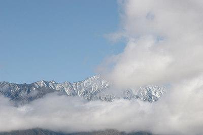 Mt. San Jacinto partially visible through the clouds,