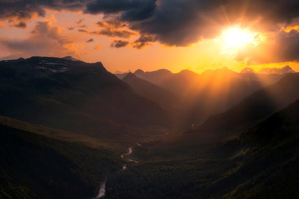 Sunburst Rays Bursting Onto Valley Floor - Going To The Sun Road, Glacier National Park, Montana