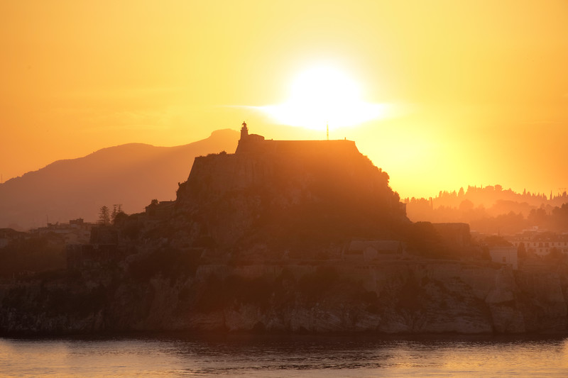 Sunset Setting Behind The Old Fortress - Corfu, Greece