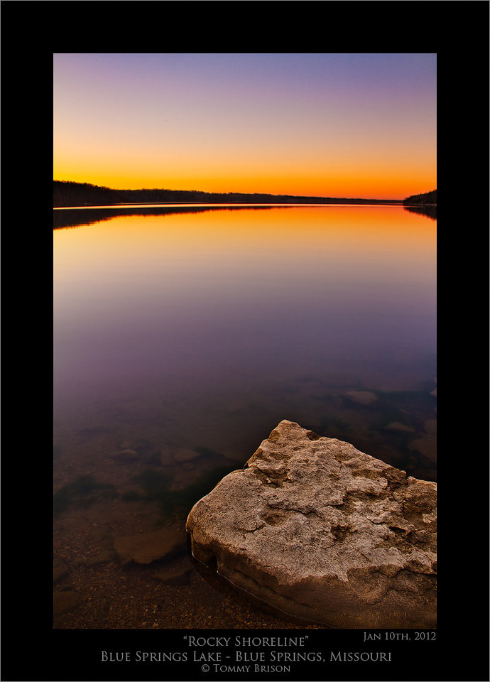 A sunset shot of Blue Springs Lake from a rocky shoreline.  I love to do landscape photography out at Blue Springs Lake which is here in the Kansas City metro area.
