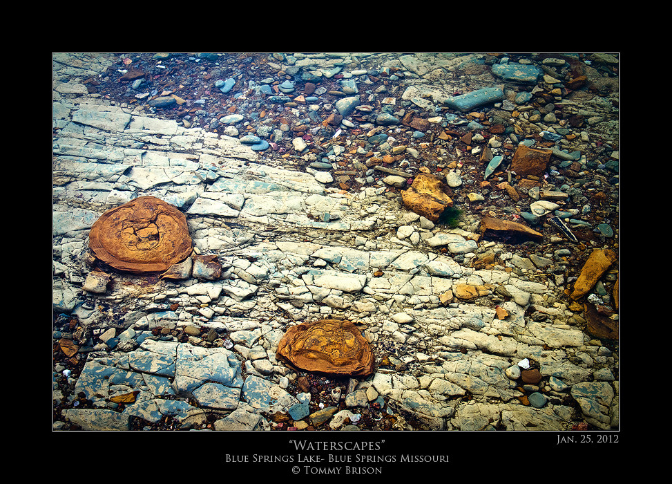 Tonight I took a fellow photographer that is a good friend of mine to one of my new shooting areas out at Blue Springs Lake.  This was shot near the shoreline with about 8 inches of water over it.  As my friend said, the brownish rocks looks like weird mushrooms or fungi.  There is so many cool things to shoot in this area.