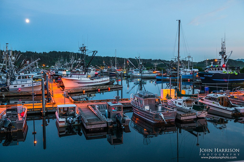 """""""Moonrise over Kodiak Alaska Fishing Boats"""" The moon was rising on this still night in Kodiak before we set off to Katmai National Park & Preserve Great reflections off the water and all of the colors of the boats! Fresh halibut and salmon coming in regularly. What a place to be. — at Katmai National Park & Preserve."""