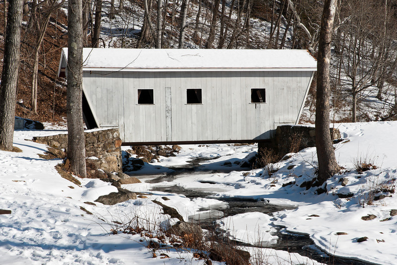 A covered bridge allows visitors to the park to cross the brook and visit the falls and access a picnic and play area.
