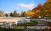 Horse Farm with White Fences in Fall Colors
