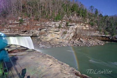 Cumberland Falls.  Moonbow taken at 8:30pm.  See the stars and movement of person wearing jacket to left of frame?