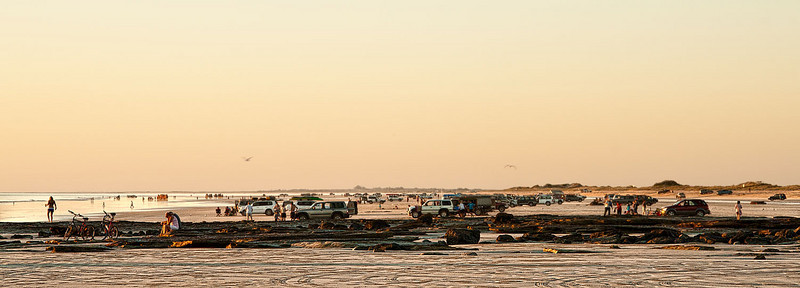 Four-wheel drives, people, camels - Broome's famous Cable Beach is a hive of activity at sunset