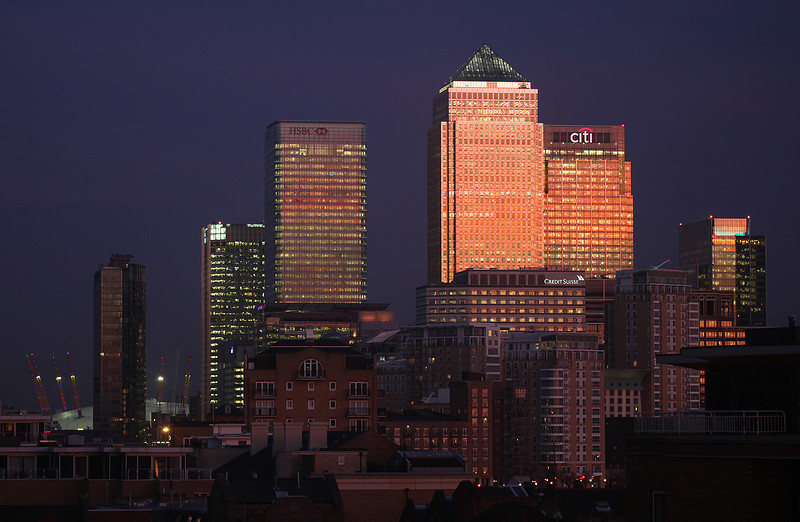 A veiw of Canary Warf at dusk with the O2 arena in the background.