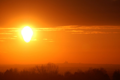 Molten sun drops towards Lincoln Cathedral