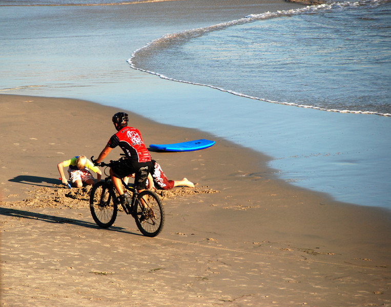 Bike rider on beach