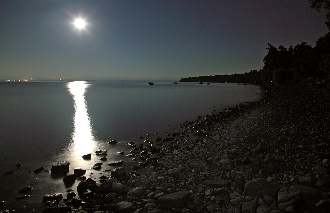 Full moon pouring light on the shore.  NY side of Lake Champlain with Vermont in the background.