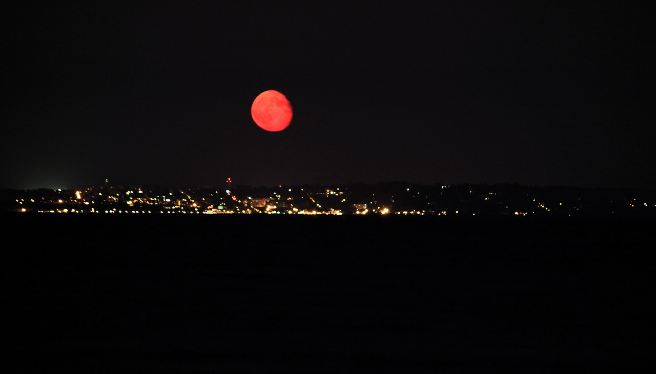 The moon rising red over Burlington, VT, and Lake Champlain.  Minimal image processing here; this is just what it looks like.