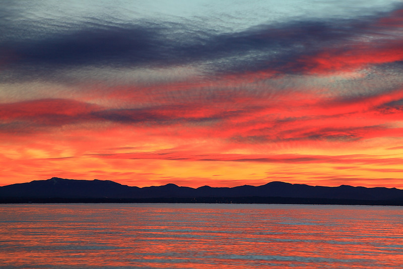 A sunrise over Vermont as seen from Lake Champlain.  Get up early and you see some crazy looking stuff.  This sunrise looked as if it was painted by Van Gogh.