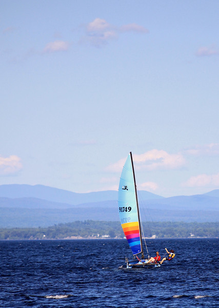 Neighbors sailing their Hobbie Cat on Lake Champlain with Vermont in the background.