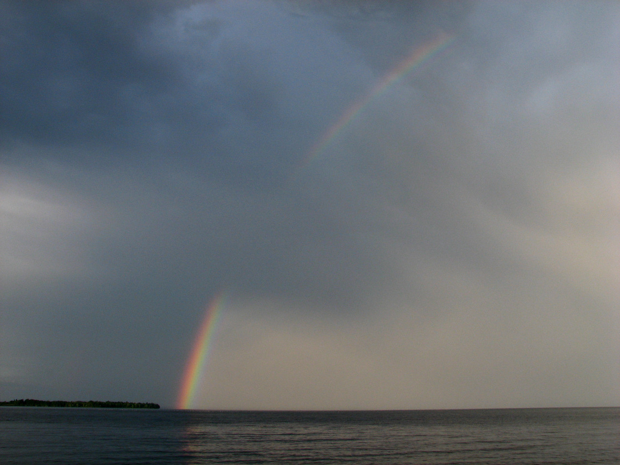 Intense rainbow touching near the south end of Schuyler Island, Lake Champlain
