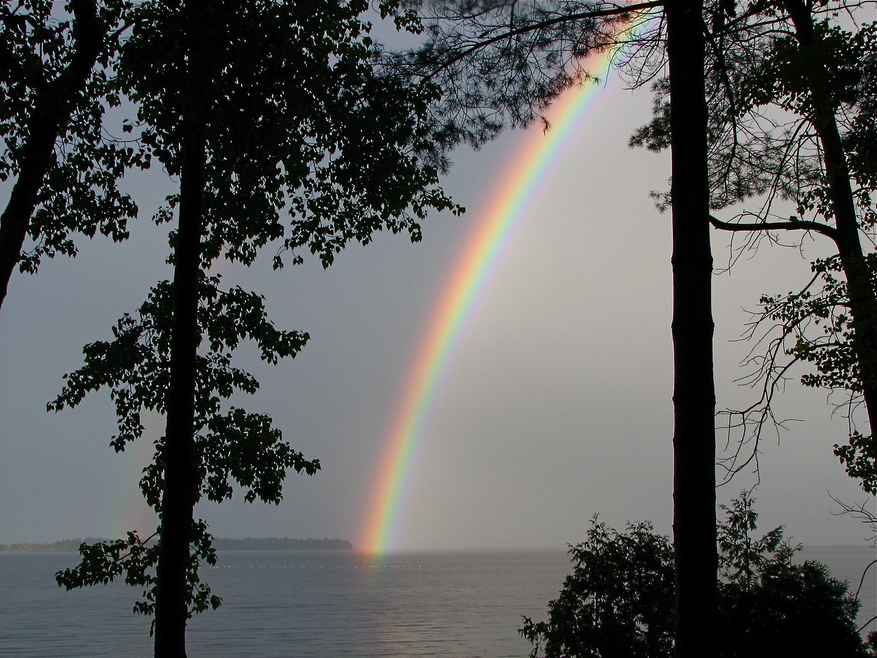 Intense rainbow touching the south end of Schuyler Island, Lake Champlain. This island was involved in the 1776 Battle of Valcour.