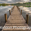 Wooden Jetty on Coniston Water at sunset, Lake District, England