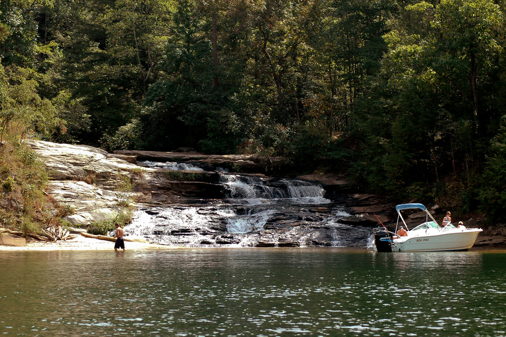 Boat and swimmer at Little River Falls onLake Keowee