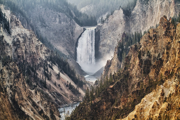 The Lower Falls at Artist Point in Yellowstone. With all the smokey haze from the regional fires, exposure was tricky (at best) so this image was digitally modified to give a lithographic type feel.