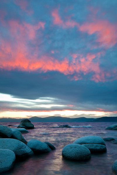 """Glow on Lake Tahoe at Sunset"" A nice pink glow emerges from the clouds from a last minute sunset on Lake Tahoe."