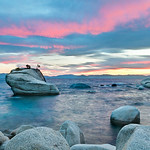 """Sunset on the Bonsai Rock and Tree in Lake Tahoe"" The massive rocks and boulders in Lake Tahoe almost look like stepping stones out to the Bonsai tree at sunset here in Lake Tahoe.  This is another summer shot of the Bonsai Rock and Tree along the eastern shore in Lake Tahoe.  It didn't seem like there was going to be any sunset that night.  At the last minute the sky just lit up with a pink glow!"