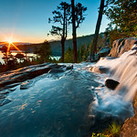 """Summer Sunrise at Eagle Falls, Lake Tahoe"" From my vacation up there last week! Just beautiful silky water flowing over the falls with my wide angle lens to capture the sunrise and the falls! (The wide angle is a 10-20mm on a 1.5x crop sensor currently). A couple images combined to keep the sky from blowing out and getting the right detail in the water.  Shot with a 3-stop Singh-Ray Daryl Benson Reverse Neutral Density Graduated filter to hold the sun from blowing out on the horizon."