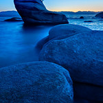 """Lake Tahoe Bonsai Rock at Sunset""  The massive rocks and boulders in Lake Tahoe almost look like stepping stones out to the Bonsai tree at sunset here in Lake Tahoe.  My first trip to the elusive tree and large waves were on the lake.  I used a long exposure at dusk to smooth the water out."