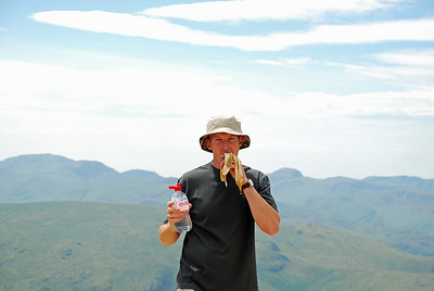 Summit of Helvellyn and Gordon is making sure he is refuelled before our decent down via Swirral edge.