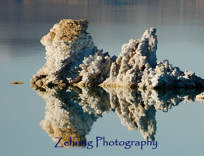 Perfect reflection of a Tufa (too'fa) formation almost resembles a sentinal looking over Mono Lake in the late afternoon sun. Mono Lake, near Lee VIning, CA is also near the eastern entrance to Yosemite Nat'l Park.